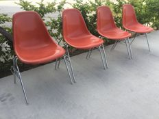 Charles and Ray Eames for Herman Miller – Set of four orange-red glass fiber chairs, model DSS