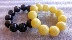 Set of 2 Round beads modified Baltic amber bracelets, Black and Egg yolk colour, hand hole ca. 55 mm, 100 grams