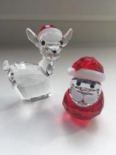 Swarovski - deer with Santa hat - rocking Santa Claus