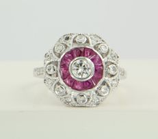 14 kt white gold ring set with ruby and 23 diamonds of approx. 1.64 ct in total, ring size 17.25 (54)