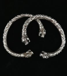 Pair of silver bracelets with lion heads - Bhutan, early 20th century