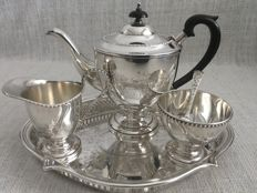 Ornate vintage set of five piece silver plated tea set with embossed decorated design. SWATKINS England. Second half of 19th century
