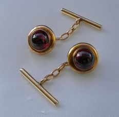 Cufflinks from the mid-19th century. Round with dark red cabochon cut carnelians Chain with bars at the end to thread through the buttonholes