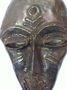 UNICA - Mask of drum steel by Danisile Ncube, Bulawayo, Zimbabwe