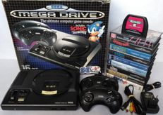 Sega Mega Drive console (PAL) with box, 2 controllers, AV cable, universal power supply and 10 games of which 9 boxed