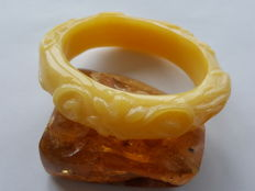 Carved Baltic Amber bangle in white butter colour, 36 grams