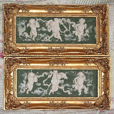 Set of two alabaster paintings with angel scenes in golden Baroque frame, 20th century