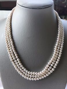 Necklace with three strands of salt water pearls 5/5.5 mm with 18 kt gold clasp.