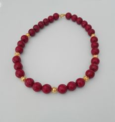 Necklace with 7 globes in gold 19kt and 30 rubellite stones cut 11mm with gold clasp 19kt