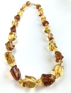 Natural Baltic Amber necklace, beads carved in flower blossom shape, 34 gr.