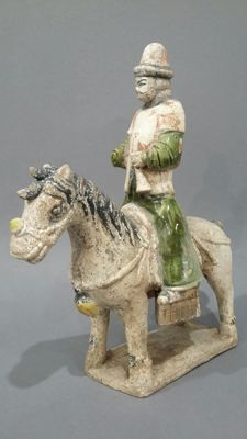 Musician on his mount. China. Terracotta.  32.5 cm.
