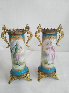 Pair of ceramic vases in Sevres style with bronze uprights, late 29th century