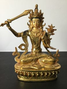 Representation of Manjushri in copper and gold patina – Nepal – early 21st century.