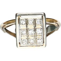 18 kt - Bi-colour yellow/white gold ring set with 9 octagon cut diamonds of approx. 0.18 ct in total - ring size: 17.5 mm