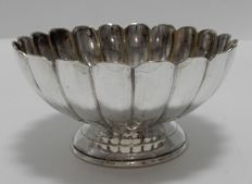 A silver plated bowl with profile edge