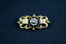 Antique enamel pin set with diamonds.