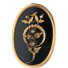 14 kt - Yellow gold brooch set with black onyx and rose cut diamonds - Length x width: 4.4 x 3.1 cm