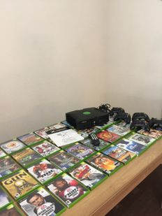 Xbox with 44 games , 5 controllers and a remote control for the xbox