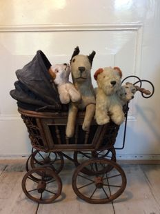 Old cuddly toy in old stroller, mid 20th century