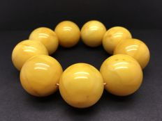 Old Baltic Amber bracelet old yellow egg yolk colour beads, 107.2 grams