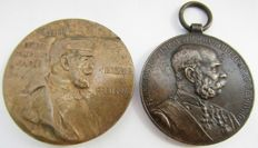 Two medals of Austria and Prussia .