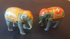 Blomer & Schuler - Germany - A. 10 cm - Pair of elephants of tin with spring mechanism - 1950s