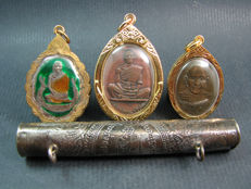 A Takrut together with 3 other Buddhist amulets - Thailand - 1982 and later.