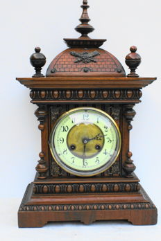 Beautiful wooden table clock from 1180-1920.