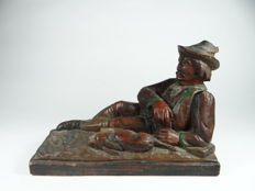 Antique wood carving of a resting hunter France - ca. 1900
