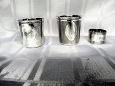 Two children's cups and a serviette ring, Christoffle Paris, mid 20th century