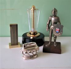 4 table lighters 1- Crown silver plated 1950 2-a knight in metal 1950 3- a torch in plexi 1960 4- replica of the Pan Am Building 1955