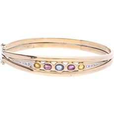 14 kt yellow-gold bangle, set with two citrines, two tourmalines, a sapphire and eight octagon-cut diamonds of approx. 0.10 ct in total. The bracelet is fitted with a box clasp with two figure-eight safety pins - diameter: 6.2 cm