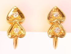 Yellow gold brilliant cut diamond heart earrings