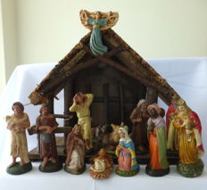 Old wooden Nativity scene with 16 mashed paper figurines and lighting