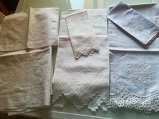 Three towels in linen embroidered with guest towels