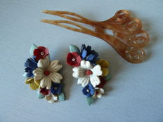Pair of celluloid clip earrings and comb signed by Camille Guillot