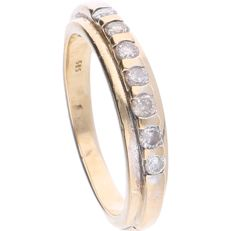 14 kt – Yellow gold ring with 7 brilliant cut diamonds, set in a row, approx. 0.28 ct in total – Ring size: 16.5 mm