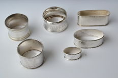 Collection of silver serviette rings: five serviette rings and  napkin ring, several countries