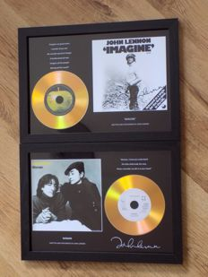 "John Lennon "" Imagine "" & "" Woman ""  framed cd displays with signed ( printed ) pictures."
