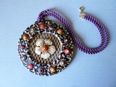 Belt buckle element mounted as a pendant on silk cord with clasp in 18K gold - France