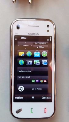 Nokia N97 Mini in White, with Charger, Earplugs and Booklet.
