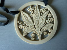 Galalith pendant with floral pattern