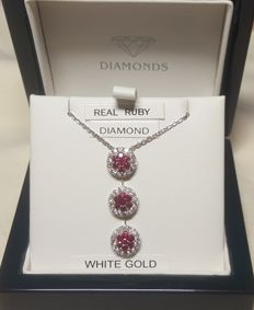 "18ct White gold ruby & diamond pendant 16"" Chain. 1.04 carat Ruby 21 stones. .87 carat diamond 42 stones."