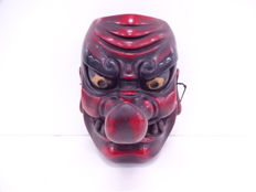 A fine wooden mask of a fierce tengu - Japan - Mid 20th century