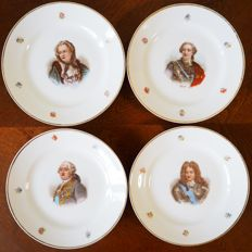 Four decorative porcelain plates with portraits of the emperors of France