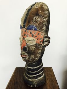 Large African wooden bust, decorated with copper