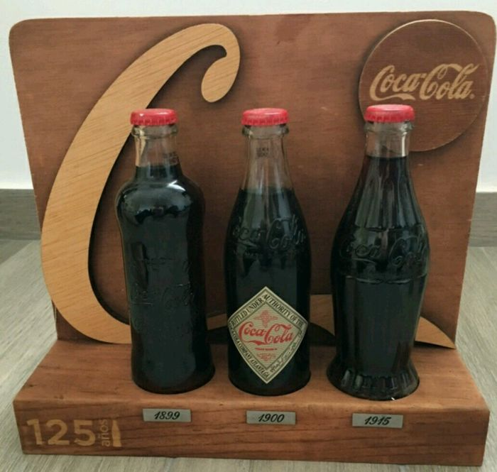 Original Coca-Cola display, three bottles