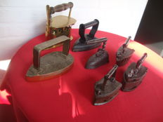 Three very old irons, of which two of copper and one of cast iron, comes with four mini-irons (7x)