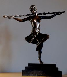 Bronze female dancer - on black marble base, 20th century.