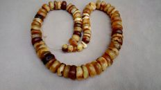 Old Amber necklace of butterscotch coloured Baltic Amber, weight: 71 gram.